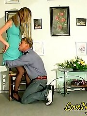 Black-stockinged chick seducing security man with the tempting upskirt view