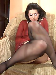 Heated cutie tenderly strokes her perky tits with her hands clad in nylons