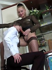 Curvy chick in red stockings thrusting her strap-on into ass of sissy guy
