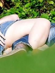 Girls lying on park grass up skirt