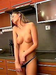 Charming blondie Lenka Janis stripping her dress and rubbing pussy in the kitchen