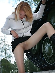 Babe takes of her skirt and wears sheer pantyhose