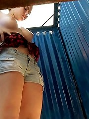 Girl in denim shorts completely undressing in a beach cabin. Beautiful big tits and shaved pussy close up. Great model with a beautiful body.