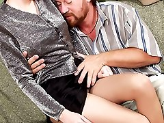 Chick squeezes dad's head between pantyhosed hips