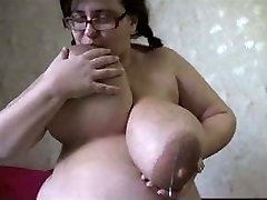 Fat White Girl Demonstrates off her Massive Milky Boobs on Camera