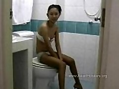 Thai Hooker Sucks Trouser Snake in the Toilet