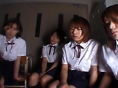 Four Japanese school femmes drooling on teacher