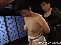 Mature bitch gets roped up and suspended in a sadism & masochism session