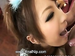 Asian schoolgirl smoking small pipe