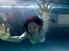 Young Japanese Girl in Sexy Bikini at a Swimming Pool
