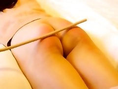 Chinese first-timer caning with gimp Niu