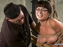 Trussed and tied slave in glasses has ejaculations