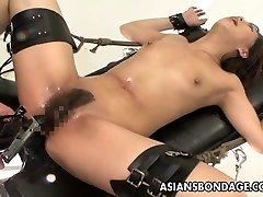 Bound Asian treats lovemaking machines like a trooper