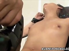 Chinese babe bond and fuckd by a fucking machine