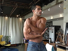 Muscle hunk sizzling posing