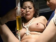 BDSM: Asian w catheter drained and re-crammed