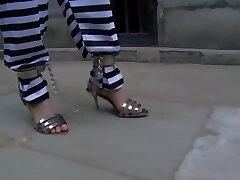 Chinese Prison Chick in Metal Bondage