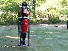 spandex bondage chick jewell caged and stored in silo