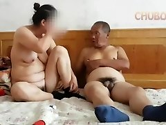 Chinese grandpa giving it to granny from behind
