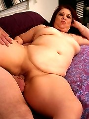 Naughty redhead plumper Nina likes to get spanked before she dishes out her shaved snatch