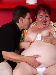 Sensuous mature redhead Margaret lures her neighbor into harpooning her fat beaver on the couch