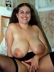 Plus-size in lylons frolicking with her breasts