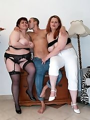 Marta and Chaste are top heavy mature plumpers having a adorable threesome on the couch