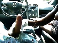 Black girl with yam-sized boobs gives hand job in car