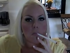 Hot Busty Light-haired MILF Smoking Solo