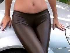 Smoking in Latex leggings with Cameltoe