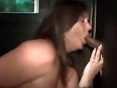 Plumper whore sucks and fucks a Big Black Cock at the gloryhole