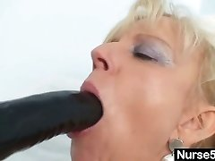 Aged blonde milf stuffing pussy with thick dildo