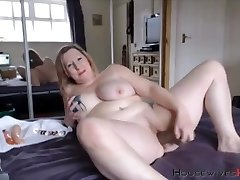Plus-size mature Carmen with huge inked tits rides a dildo