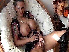 Tattooed German Woman with big Orbs gets fucked