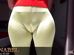 Curvy nubile ambles down the street flaunting cameltoe