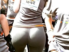 a woman in leggings with immense chubby butt