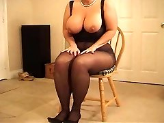 Busty curvaceous MILF in pantyhose heeljob