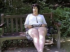 Taking off her thongs in the park