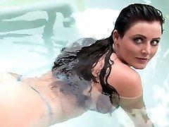 Meaty breast brunette plays in water