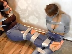 two big breast ladies bound up with ductape
