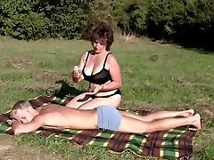 Brown-haired BBW-Milf Outdoors by Young Man