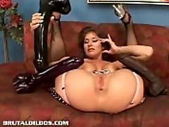 Busty babe Felony fills her cunny with a monster fake penis