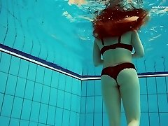 Gorgeous Vesta stripping underwater in arousing solo video