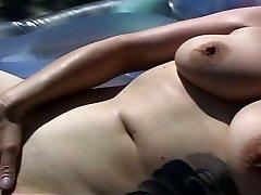 Horny MILF splattering by the pool