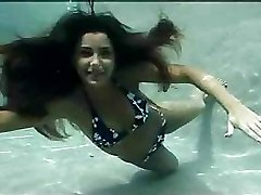 Great underwater sexual experience with cute slender dark-haired