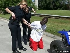 Black convict used by two milky police women for butt nuzzling and three-way