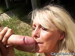Curvy mature lady drools on fat younger cock with passion