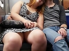 Massive lady on the subway sits with her legs open