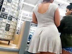 Candid butt mixed girl in dress