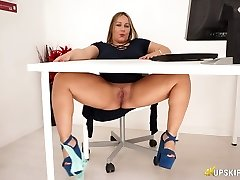 Chubby English nympho Ashley Rider touches her giant muff in the office